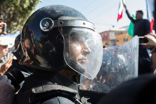 Federal and local police responded with riot gear to a demonstration in opposition to the migrant caravan that arrived in Tijuana over the past week. Protesters marched towards the shelter where 2,400 migrants are being housed, then were stopped by Tijuana's municipal police.
