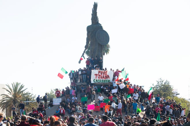Tijuana residents march in opposition of the migrant caravan having arrived in the city of Tijuana on the border between Mexico and the U.S. The marched walked towards the shelter were 2000 migrants are being housed and were stopped by Tijuana's municipal police before reaching the shelter.