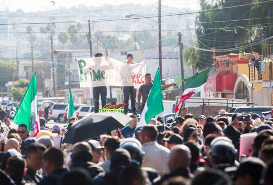Tijuana residents march in opposition to the migrant caravan that arrived in Tijuana over the past week. Protesters marched towards the shelter where 2,400 migrants are being housed, then were stopped by Tijuana's municipal police.