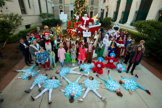 Visitors enjoy the festivities during last year's Pensacola Winterfest Preview Night Tour in downtown Pensacola.