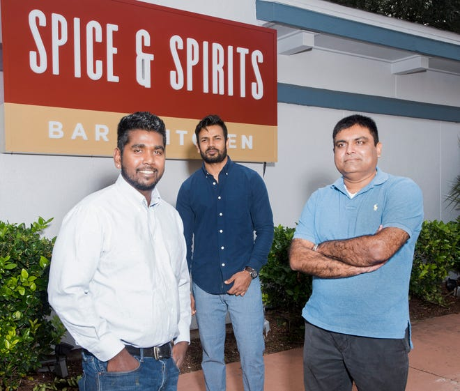Spice and Spirits General Manager, Omkar Thakur, Chef Iqbal Siddique, and Owner, Pritesh Patel, announce the opening date of their new restaurant and bar on New Warrington Road on Monday, Nov. 19, 2018. The new eatery on the corner of New Warrington and Entrance Road is scheduled to open in early Dec.