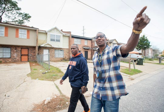 Rodney Jones, president of the Pensacola Branch of the NAACP, right, gives Kenneth Daggans a tour of his old neighborhood in Pensacola on Monday, November 19, 2018.  Both former gang members have joined forces to help youth avoid the mistakes of their past.