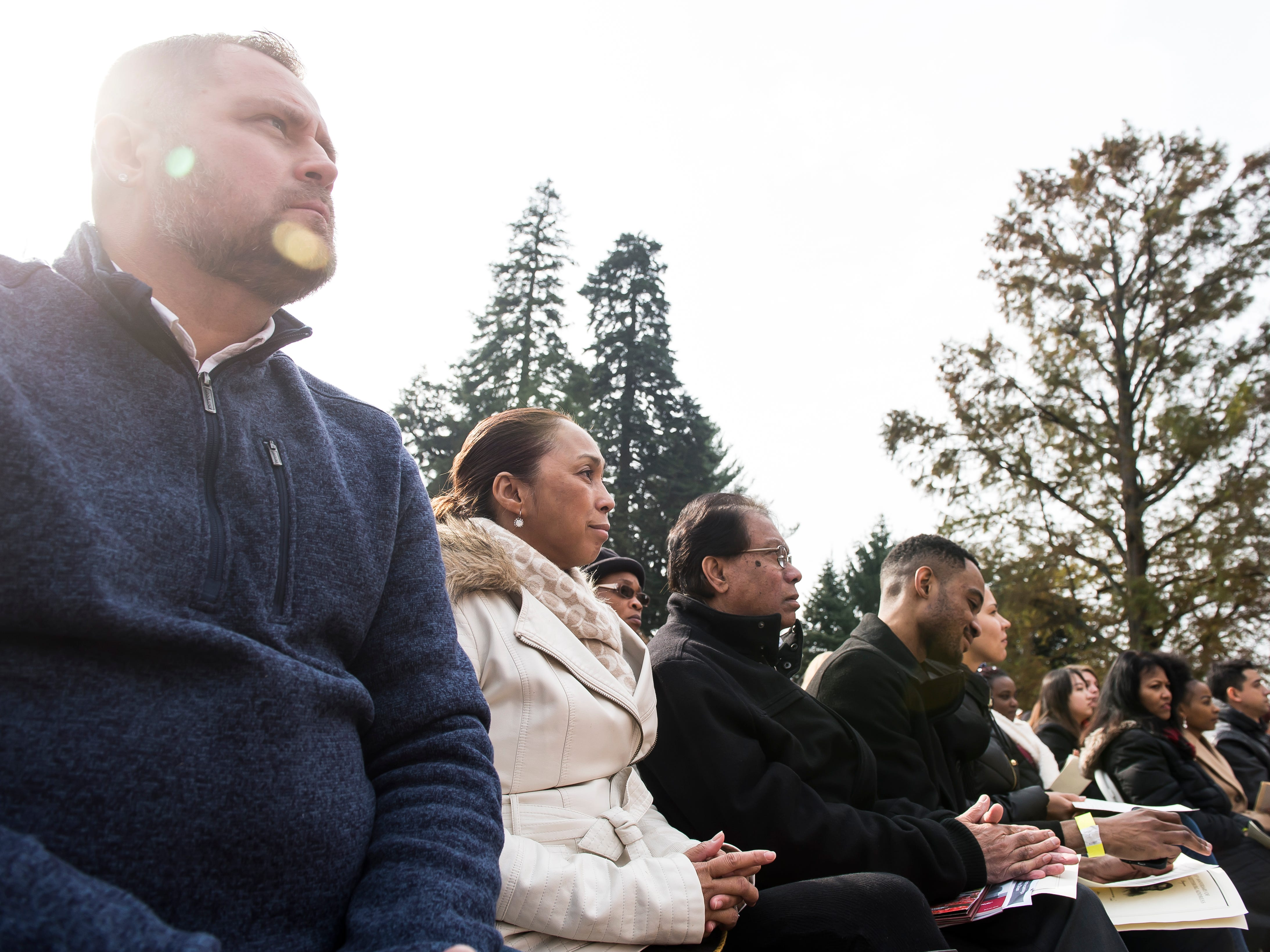 A group of soon-to-be U.S. citizens wait to take the Oath of Allegiance during a naturalization ceremony on Dedication Day in Gettysburg on November, 19, 2018.