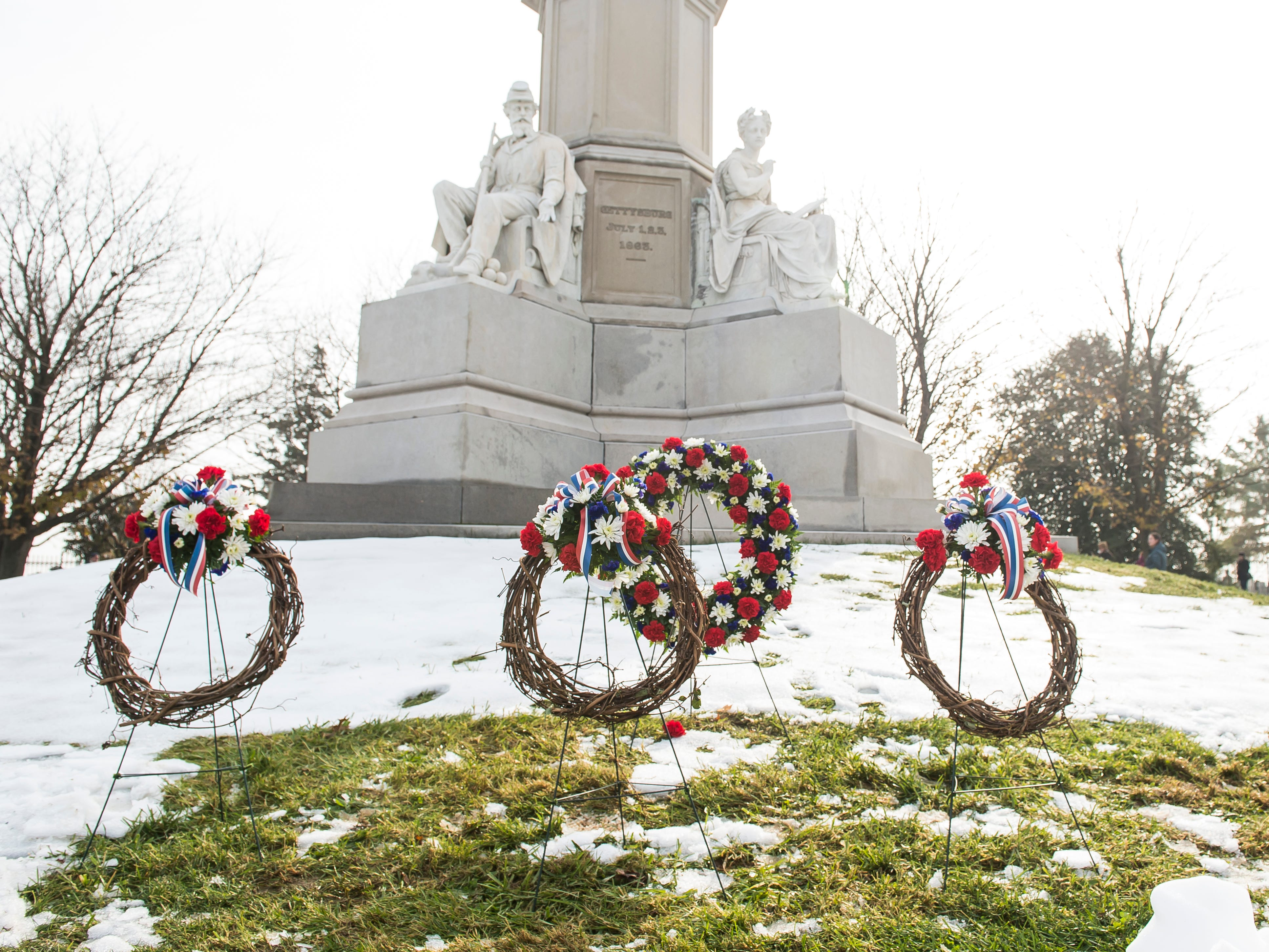 Four memorial wreaths sit in front of Soldiers' National Monument in Gettysburg National Cemetery on Dedication Day November, 19, 2018.