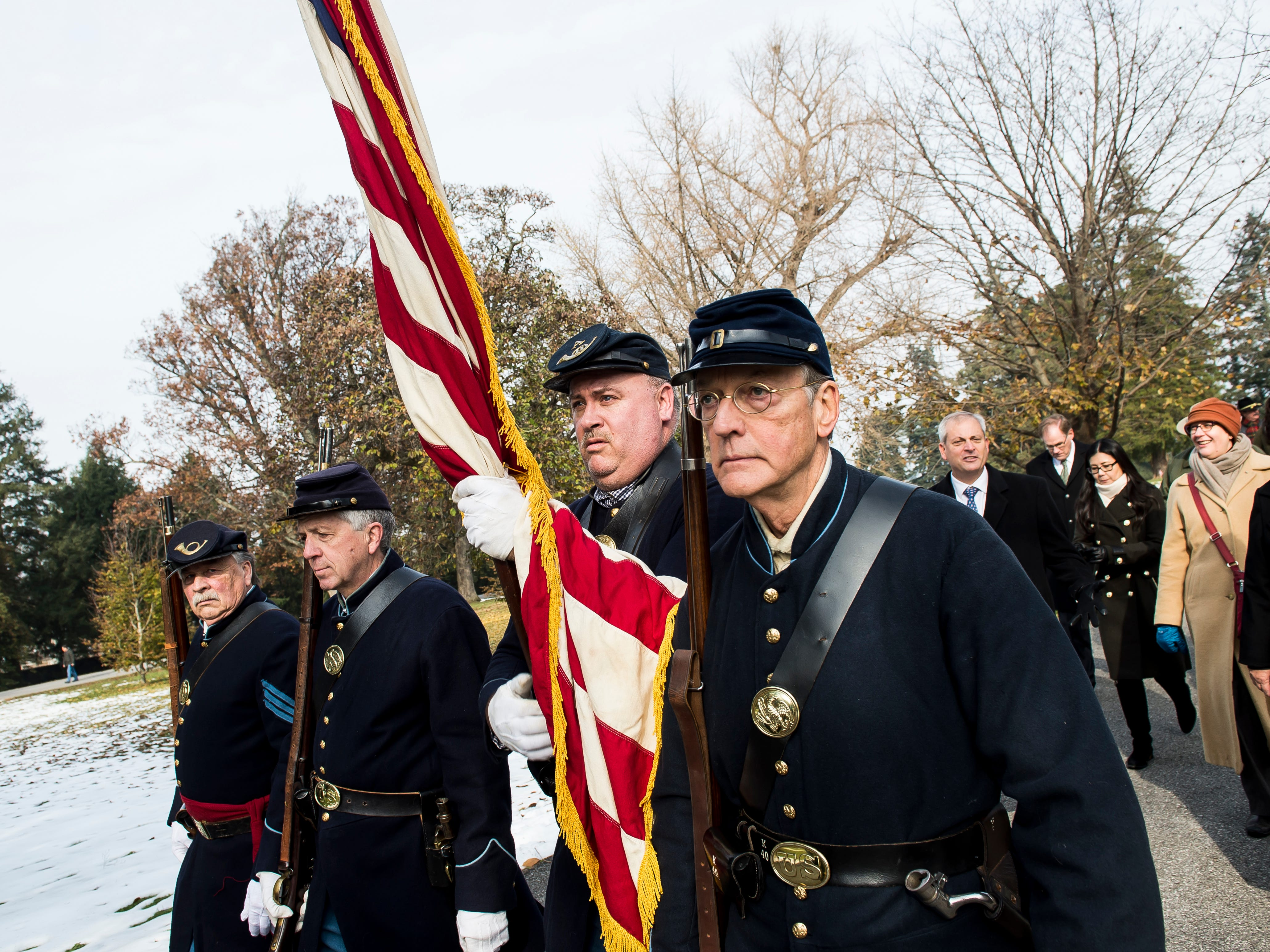 Members of the 11th PA Volunteer Infantry Fife and Drum Corps Color Guard march from Soldiers' National Monument following the laying of memorial wreaths ceremony during Dedication Day in Gettysburg on November, 19, 2018.