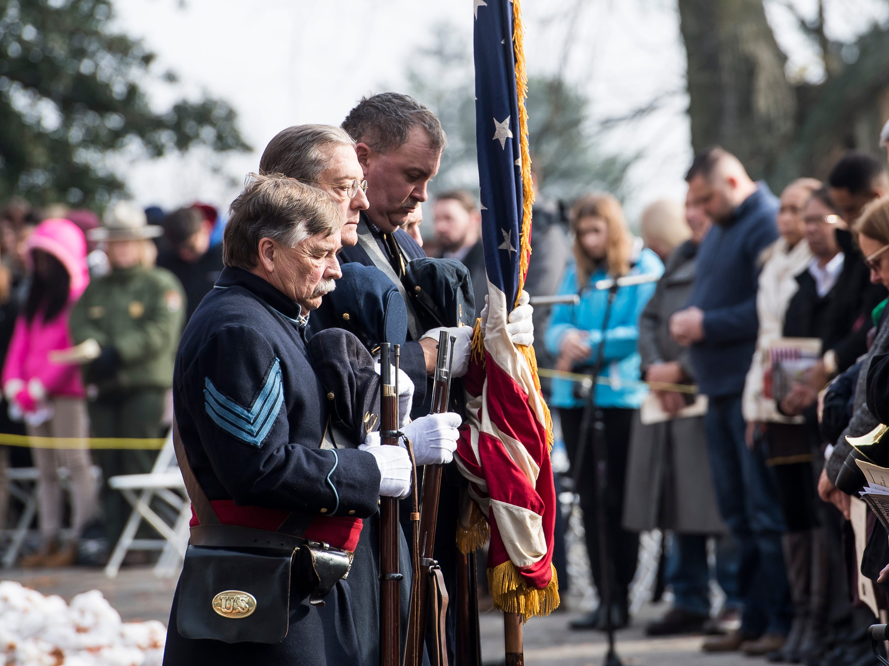 Members of the 11th PA Volunteer Infantry Fife and Drum Corps Color Guard bow their heads in prayer during Dedication Day in Gettysburg National Cemetery on November, 19, 2018.