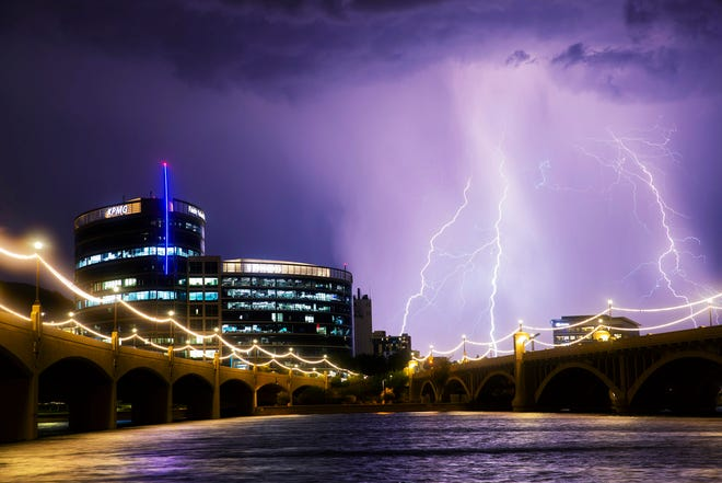 Lightning strikes over Tempe Town Lake during a monsoon storm on Aug. 10, 2018.