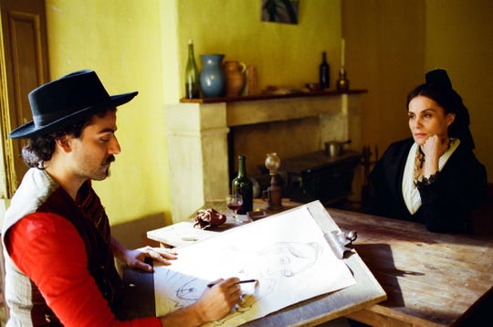 "In ""At Eternity's Gate,"" Paul Gauguin (Oscar Isaac) creates a portrait of Madame Ginoux (Emmanuelle Seigner)."