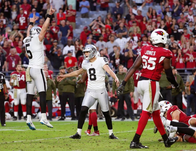 Oakland Raiders kicker Daniel Carlson (8) celebrates with holder Johnny Townsend (5) after kicking the game-winning field goal against the Arizona Cardinals as time expires in the fourth quarter Nov. 18th at State Farm Stadium.