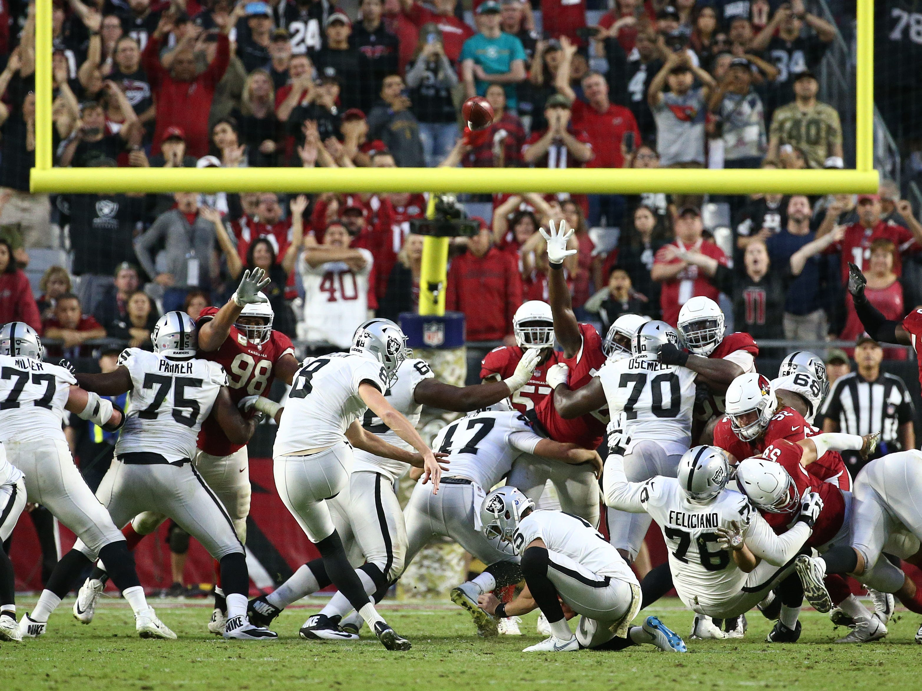 Oakland Raiders' Daniel Carlson (8) kicks a game winning field goal to end the game against the Arizona Cardinals on Nov. 18 at State Farm Stadium.
