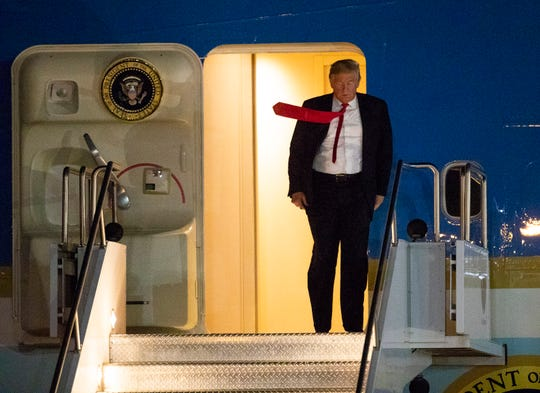 President Trump walks off Air Force One after arriving at Phoenix Sky Harbor  International Airport on Oct. 18, 2018.