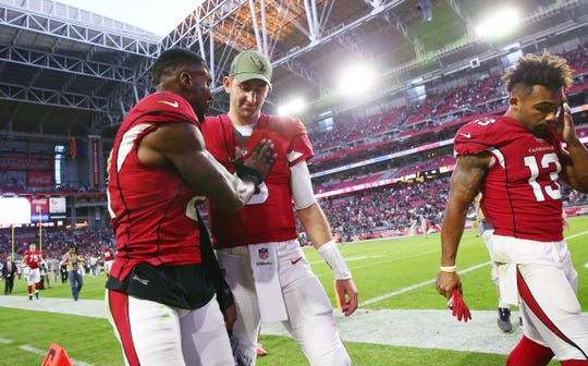 Arizona Cardinals Patrick Peterson consoles Josh Rosen after losing to the Oakland Raiders 23-21 during a game on Nov. 18 at State Farm Stadium.
