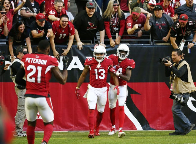 Arizona Cardinals wide receiver Christian Kirk (13) makes a touchdown catch against the Oakland Raiders in the first half during a game Nov. 18 at State Farm Stadium.