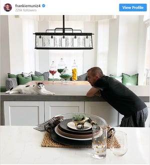 Actor Frankie Muniz with his cat Jeri. Another of Muniz's cats turned on the faucet in Muniz's five-story central Phoenix brownstone and flooded the place while Muniz was in France for a family funeral.