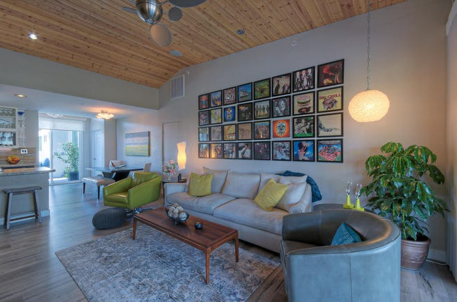 One of the updates the owners made was to add a tongue-and-groove ceiling to the living rooms.