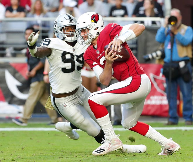 Arizona Cardinals quarterback Josh Rosen (3) evades pressure by Oakland Raiders defensive end Arden Key (99) during the second quarter Nov. 18th at State Farm Stadium.
