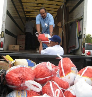 It takes months of planning to prepare the drop-off sites, recruit and organize volunteers for Society of St. Vincent de Paul's annual Turkey Tuesday.