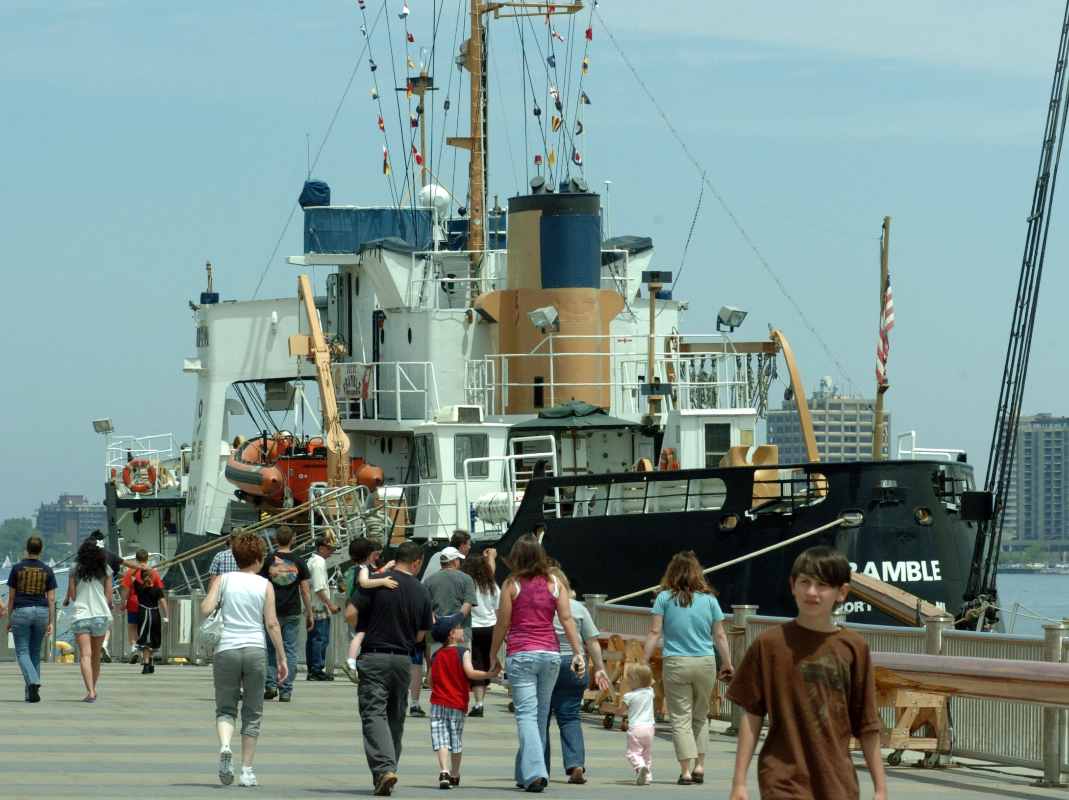 The decommissioned USCG cutter Bramble is seen beyond visitors to the Port Huron Seaway Terminal, Saturday June 5, 2010, during the Be a Tourist in Your Own Towns event.