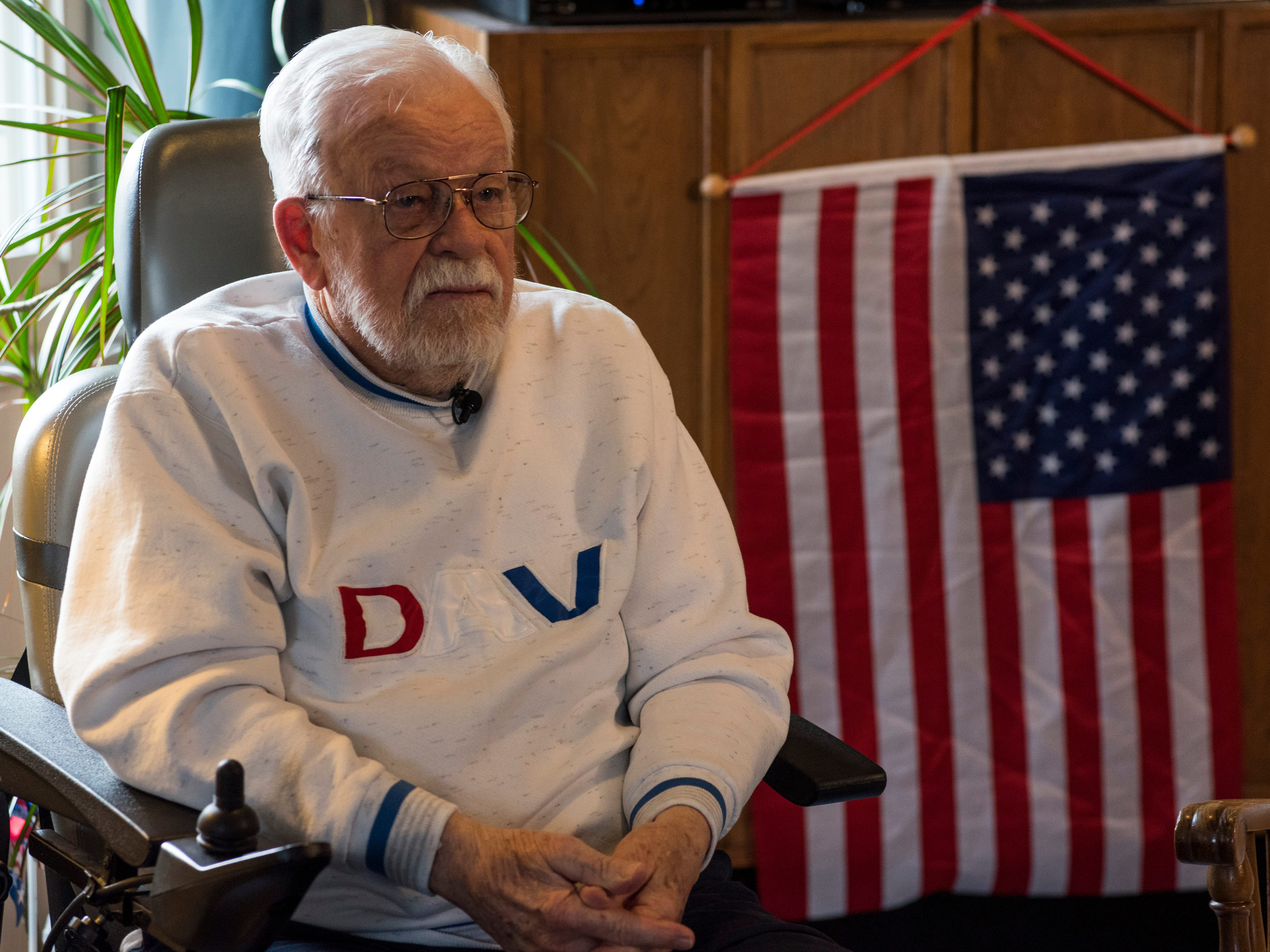 William Turney sits in the dining room of Manor Adult Foster Care  Monday, Nov. 19, 2018 after a recognition ceremony. Turney, a 92-year-old World War II veteran, wanted to be a police officer after the war but couldn't because of height requirements.