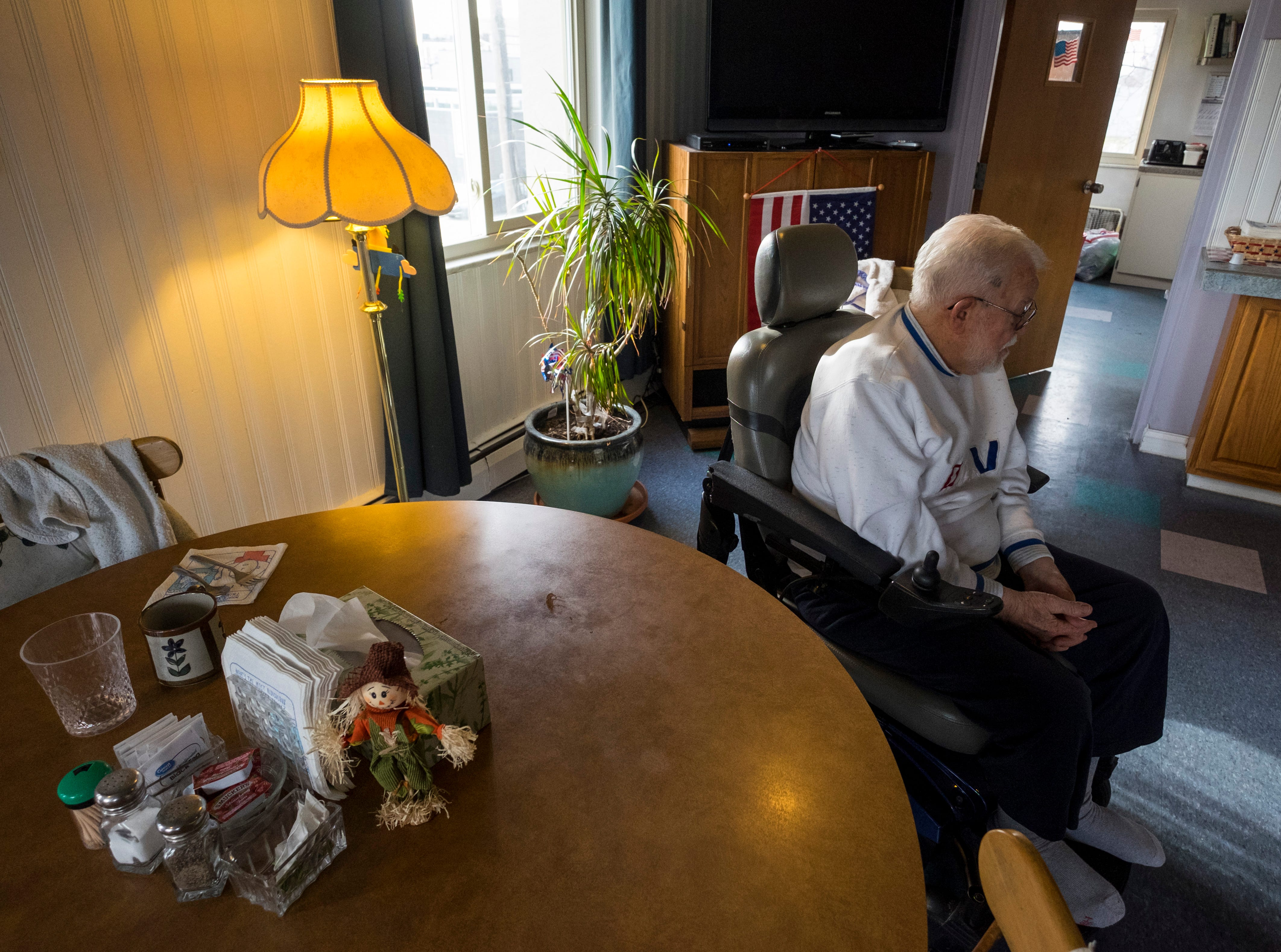 William Turney sits in the dining room of Manor Adult Foster Care  Monday, Nov. 19, 2018 before a recognition ceremony. Turney, a 92-year-old World War II veteran, wanted to be a police officer after the war but couldn't because of height requirements.