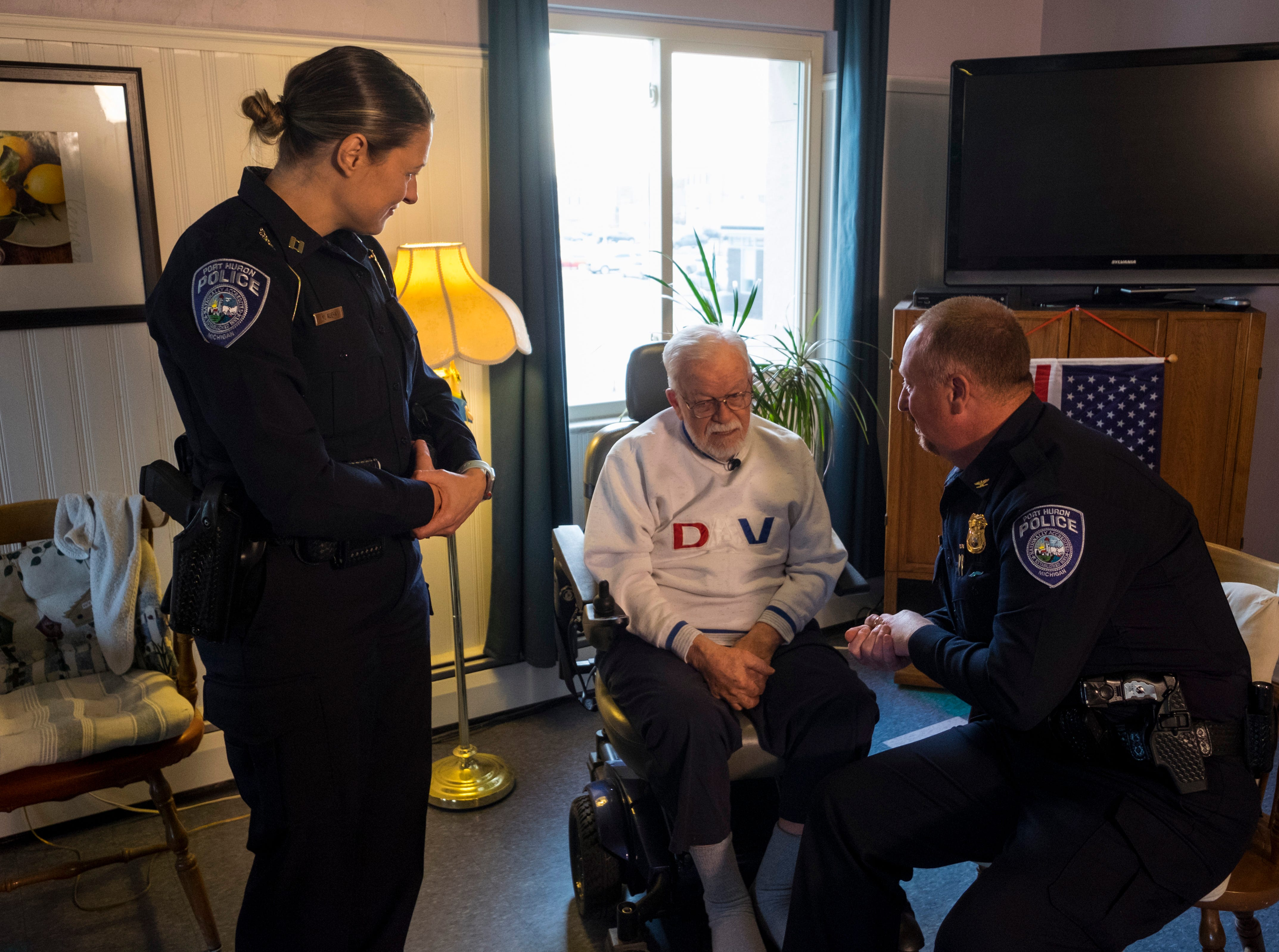 William Turney, center, speaks with speaks with Port Huron Police Chief Joseph Platzer, right, and Capt. Marcy Kuehn Monday, Nov. 19, 2018, before a recognition ceremony. During the ceremony, Turney was presented a plaque, a challenge coin and two of the department's patches.