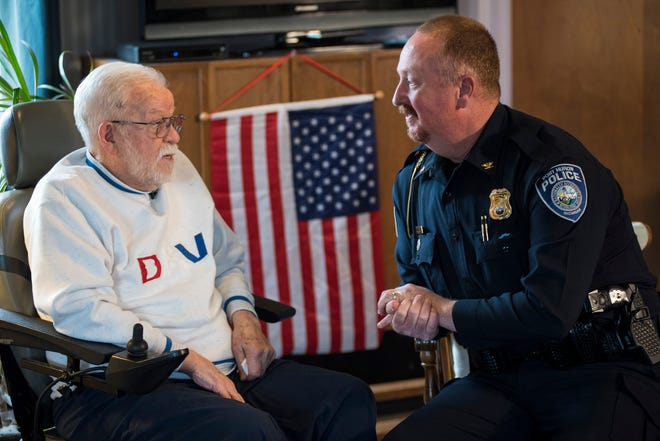 Port Huron Police Chief Joe Platzer, right, talks with William Turney before a recognition ceremony Monday, Nov. 19, 2018. Turney, a 92-year-old World War II veteran, wanted to be a police officer after the war but couldn't because of height requirements.