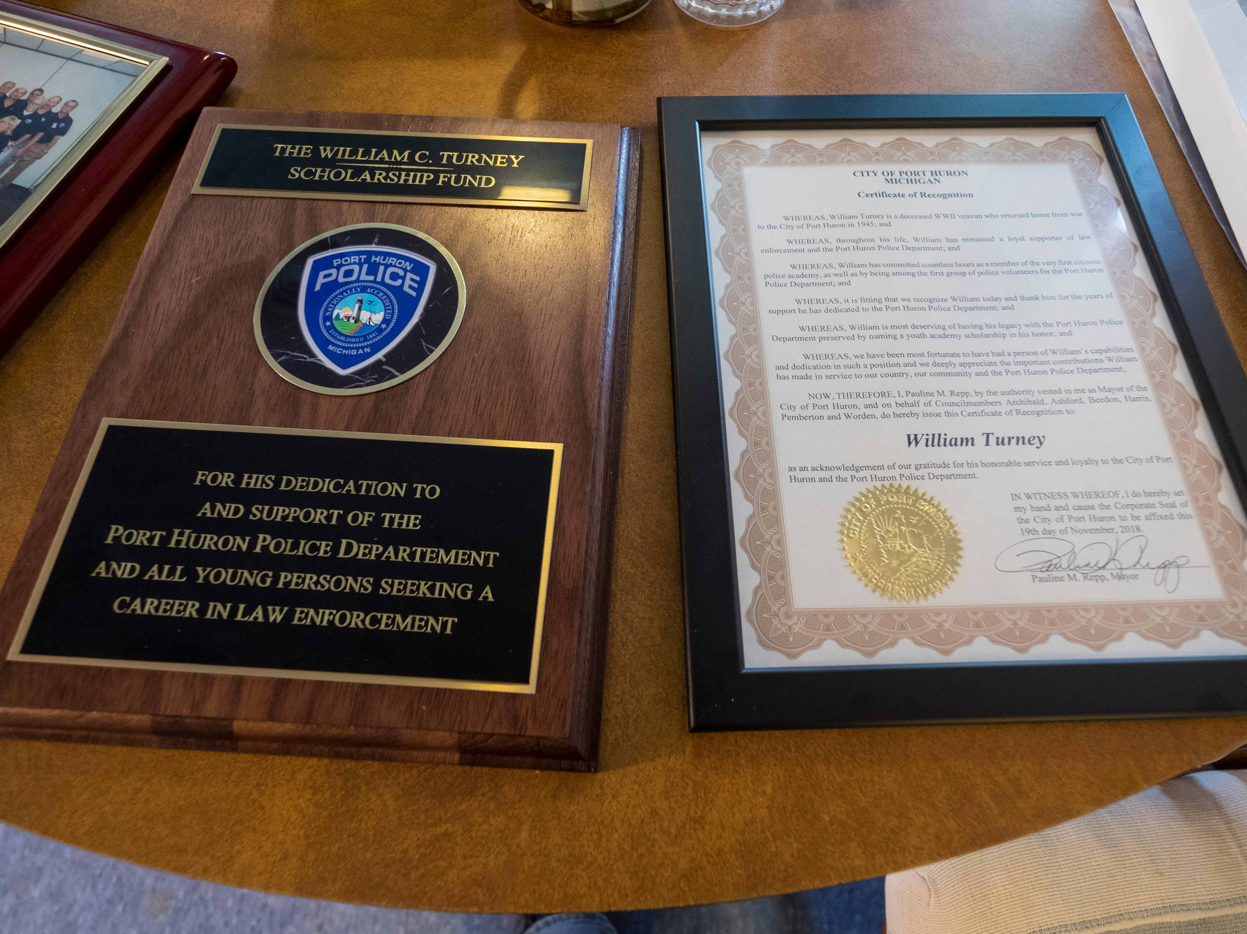 A plaque by the Port Huron Police Department and a certificate of recognition for William Turney sit on a table after being presented to Turney. The department's William Turney Scholarship Fund will award $500 toward law enforcement education to students who attend the Youth Police Academy.