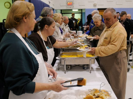 Thanksgiving dinner is served at the Salvation Army Citadel in Port Huron.