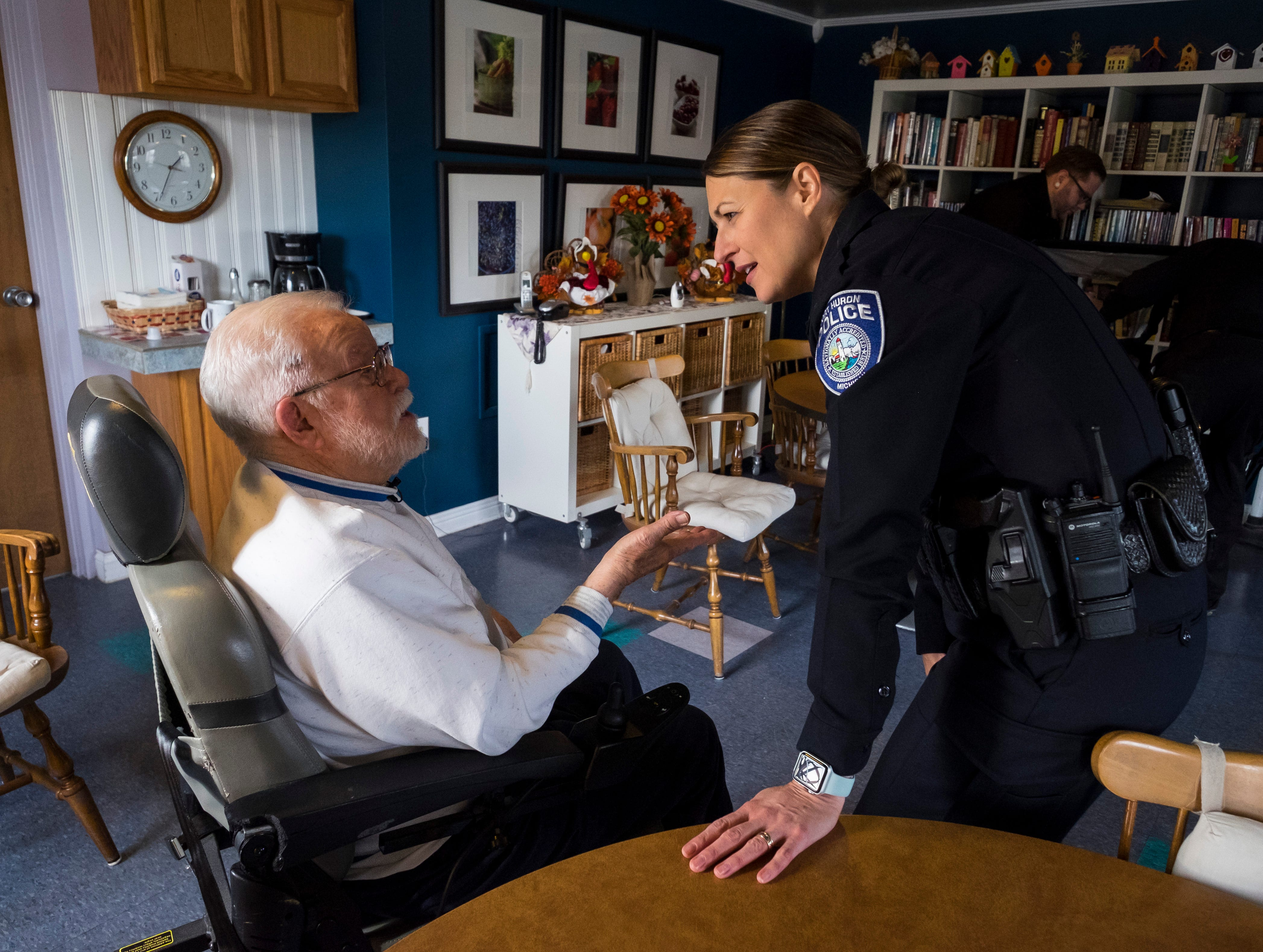 William Turney, left, speaks with Port Huron Police Capt. Marcy Kuehn  Monday, Nov. 19, 2018, before a recognition ceremony.