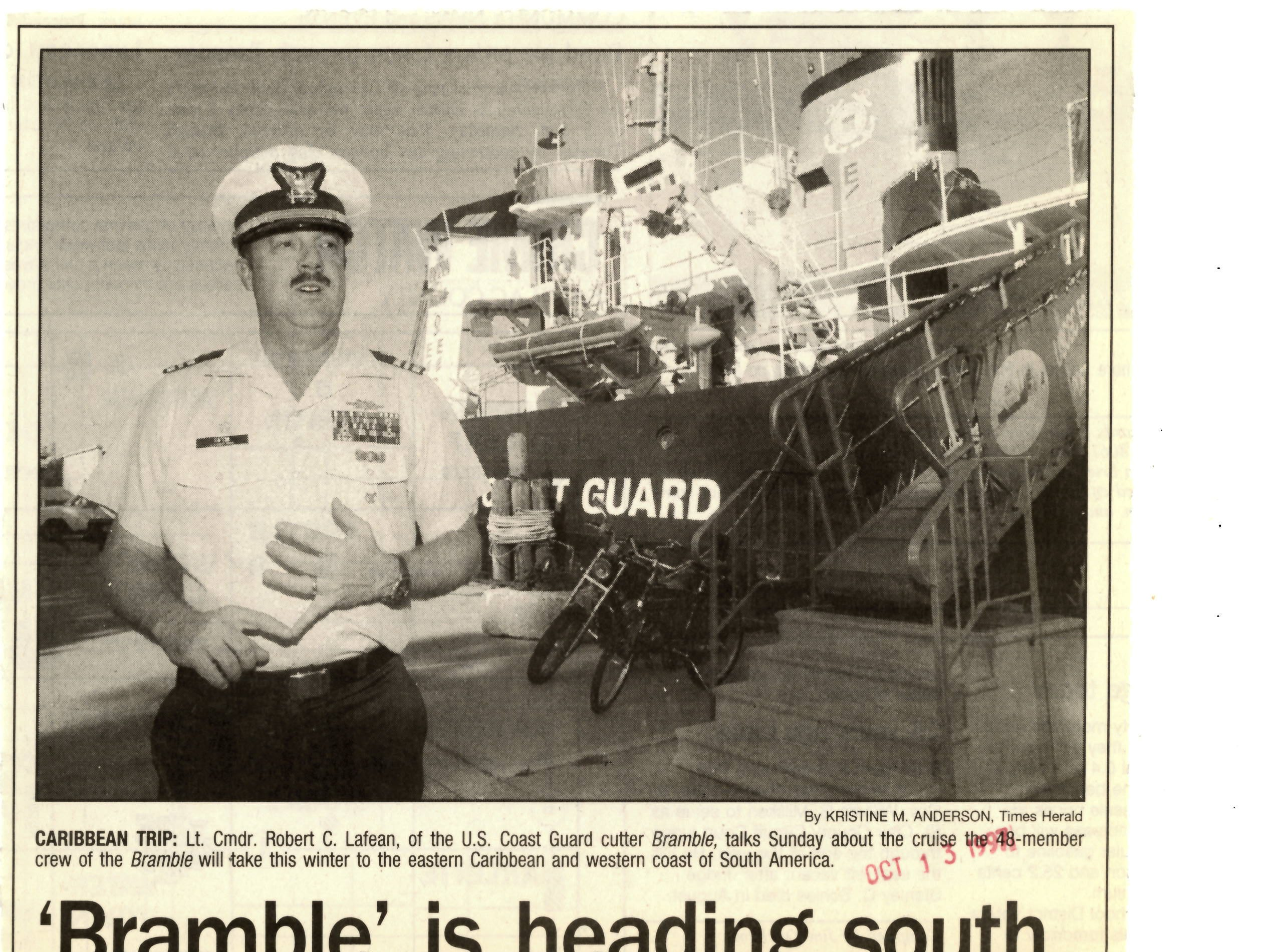 A newspaper clipping from October 1997 shows former USCGC Lt. Cmdr. Robert Lafean standing in front of the USCGC Bramble before the ship leaves to tour South America to help train other coast gards.