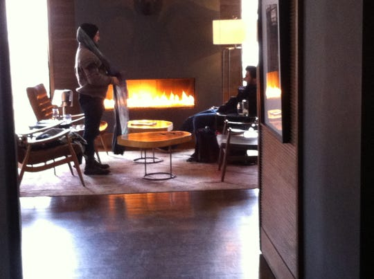 With a fireplace and a view of the falls,  Roundhouse's 2EM cocktail lounge feels special.