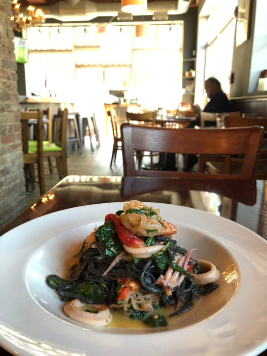 House-made squid ink seafood spaghetti is one of the dishes served at Gigi Trattoria in Rhinebeck.