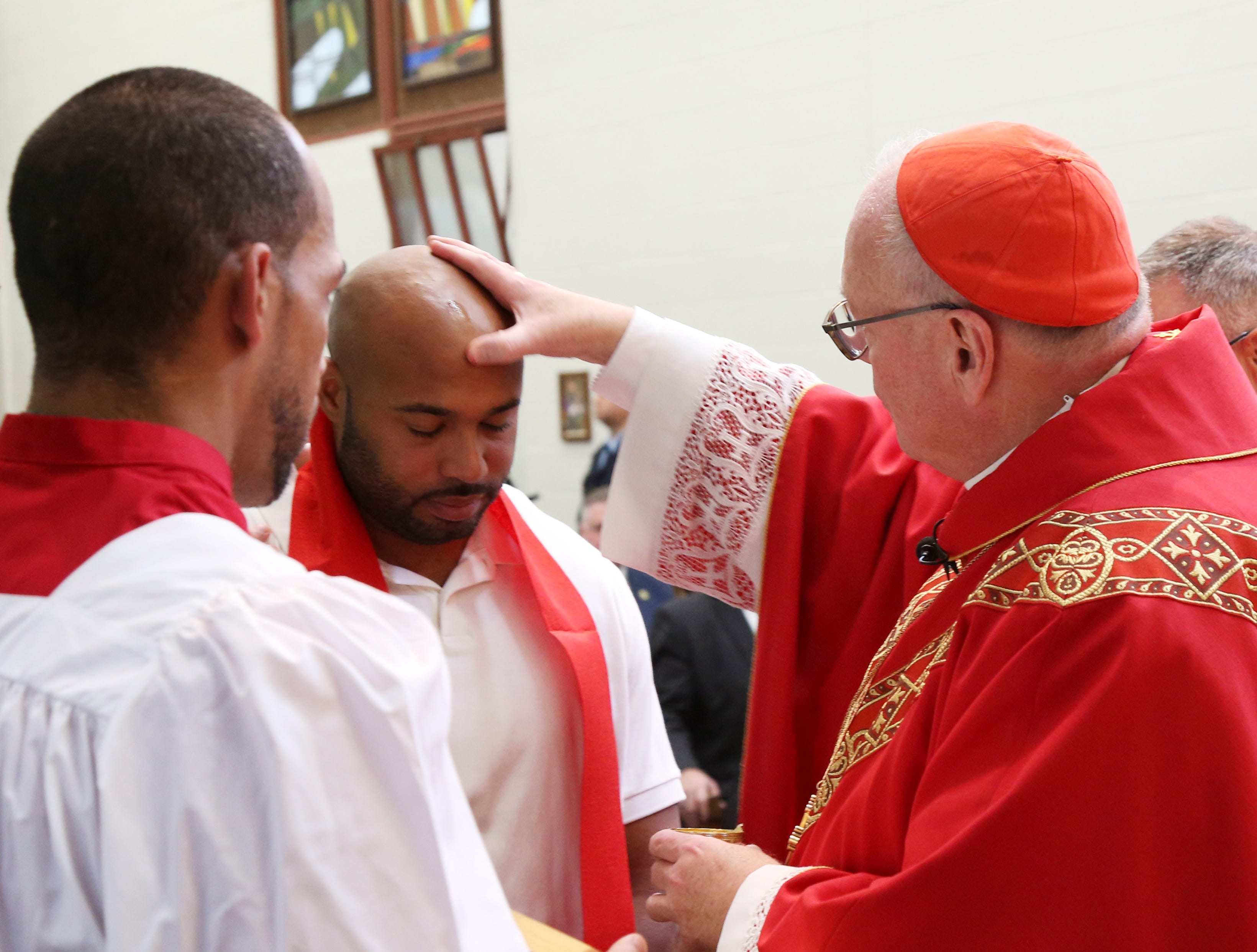 Patrick G. Smith receives the sacarment of Confirmation from Cardinal Timothy Dolan at Shawangunk Correctional Facility in Wallkill on November 19, 2018.