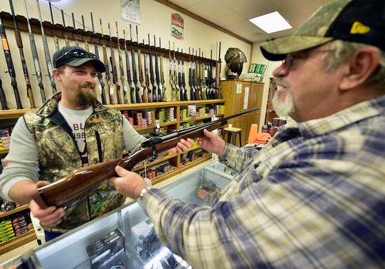 Travis Carbaugh, left, of Keystone Outdoors, Fort Loudon, helps costumer Allan Andrews check out a new rifle on Monday, November 19, 2018. Local hunters are gearing up for upcoming rifle deer hunting season which runs from Nov. 26 - Dec. 8.