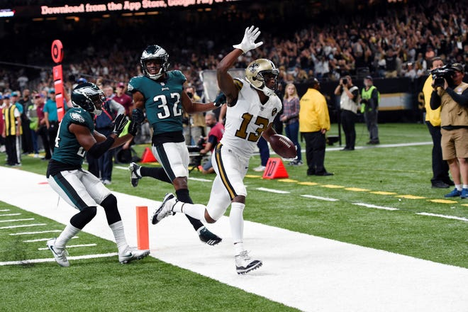 New Orleans Saints wide receiver Michael Thomas (13) scores a touchdown against Philadelphia Eagles cornerback Rasul Douglas (32) and free safety Corey Graham (24) in the second half of an NFL football game in New Orleans, Sunday, Nov. 18, 2018. (AP Photo/Bill Feig)