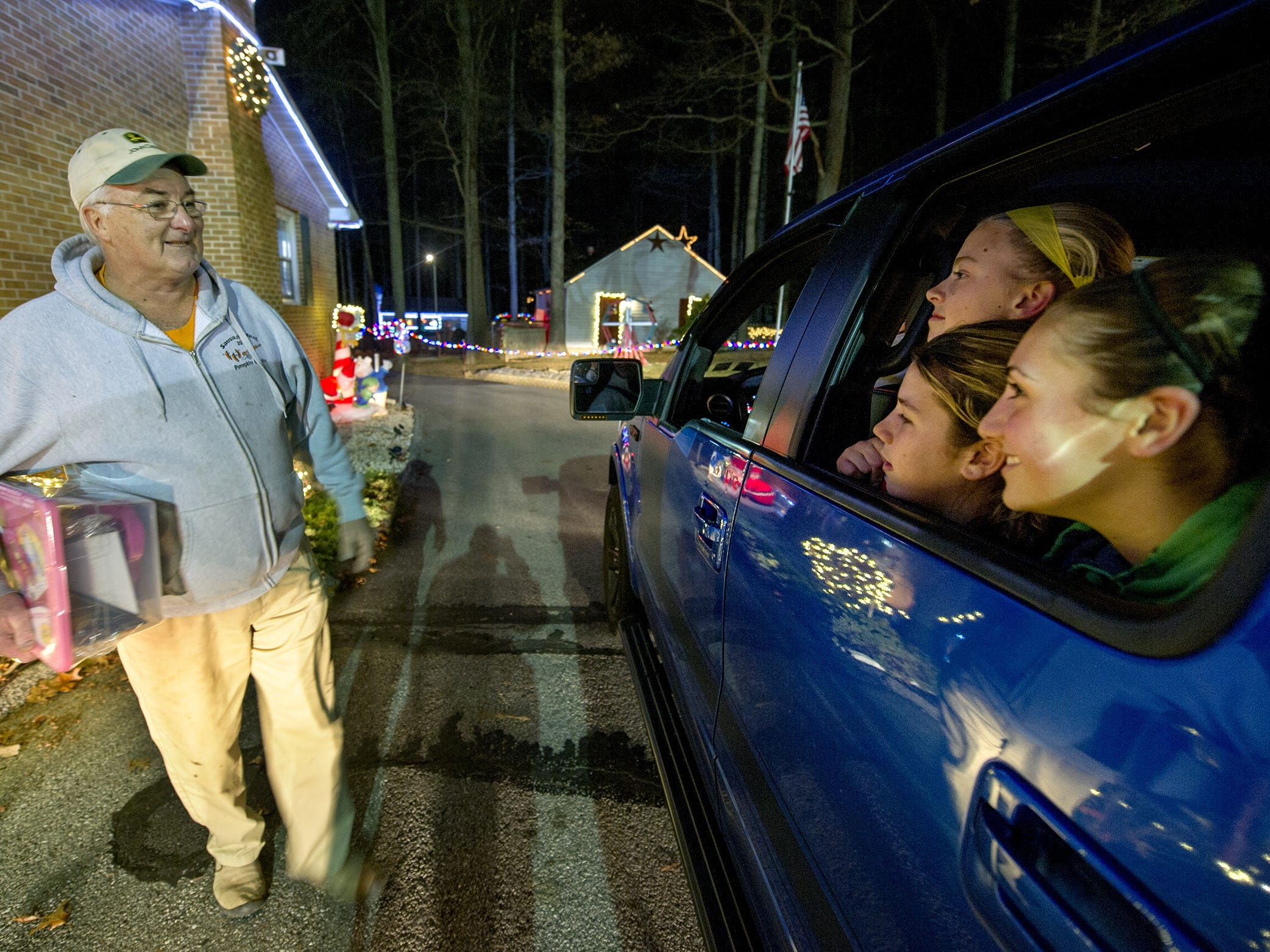 Donnie Webb greets visitors as they drive through his York Township property on December 7, 2015 to look at his Christmas display.