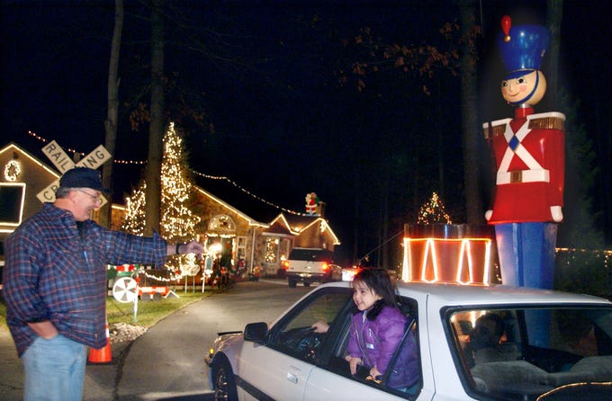 Donnie Webb greets visitors to his Christmas display on Christmas Day 2001.