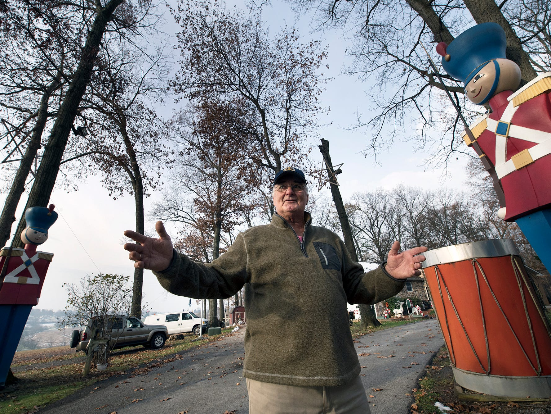 Donnie Webb stands with part of his Christmas display that stays up all year at his York Township home on Monday. After a tough year, Webb has decided to discontinue the public display this year after 27 years. The large soldiers were once part of a Christmas display at the Bon-Ton.