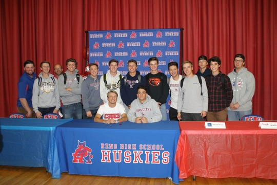 Garret Damico and August, seated, will continue playing baseball in college