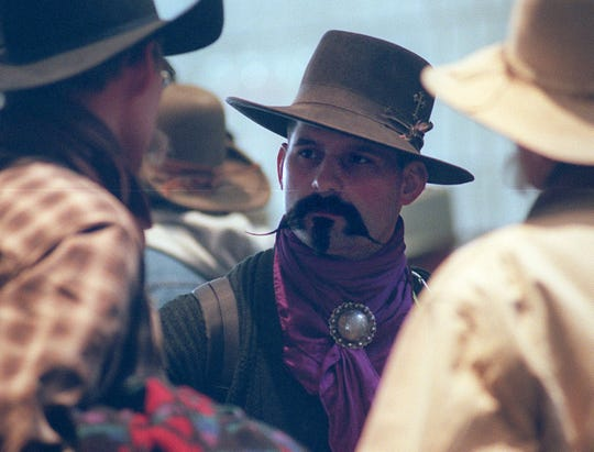 Cowboy Poetry participant Rod Taylor, center, from Oregon, talks to fellow poetry lovers during the 2000 Cowboy Poetry gathering in Elko.