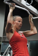 Katie Hillson performs pull-ups as she works out at the Caughlin Club Fitness Center on July 12, 2011.