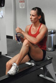 Katie Hillson has a drink of water while working out at the Caughlin Club Fitness Center on July 12, 2011. Katie Hillson was seriously injured in a skiing accident.