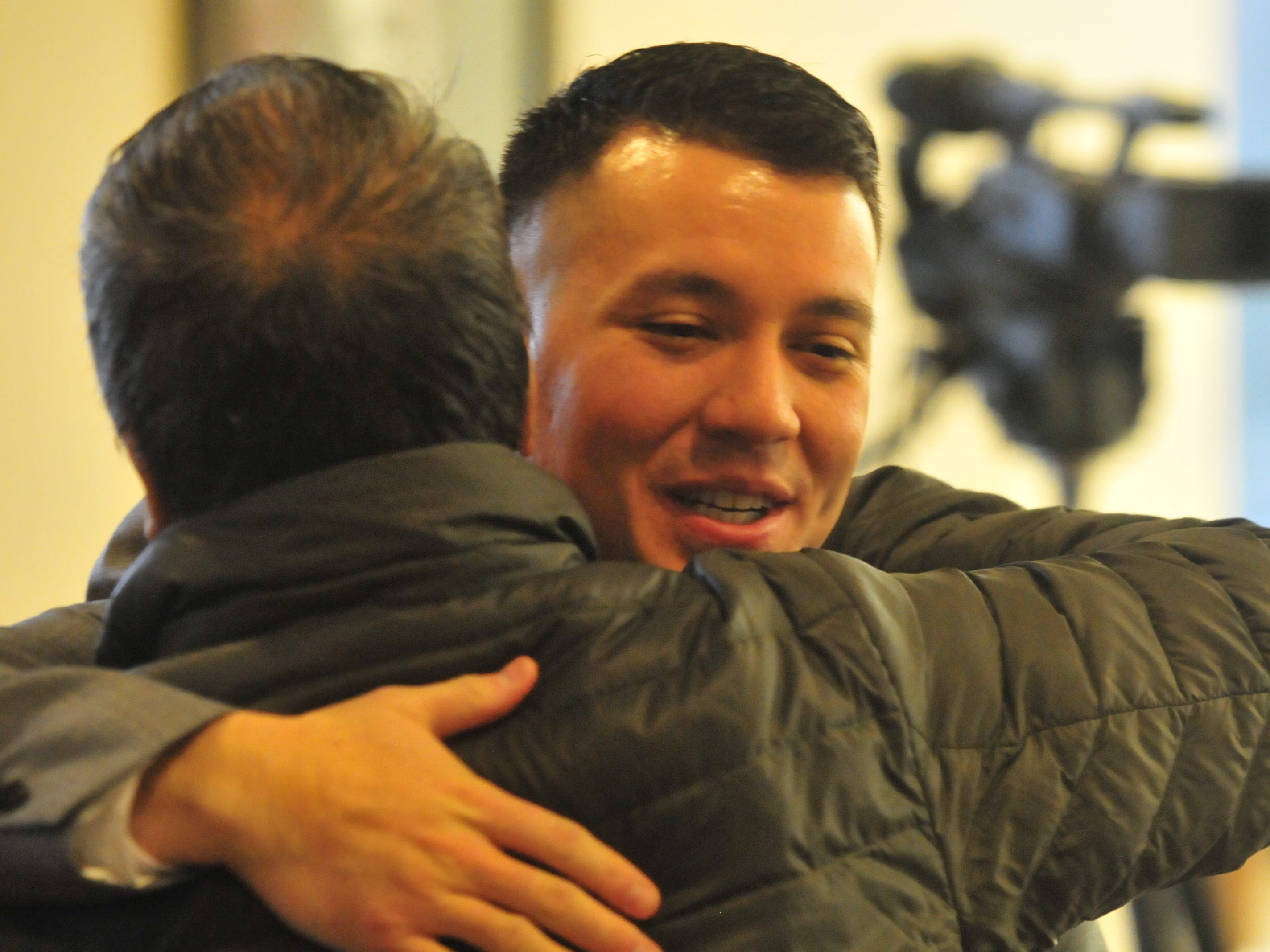 Joshua Anicete receives congratulations Monday after he was sworn in as a Richmond Police Department officer.