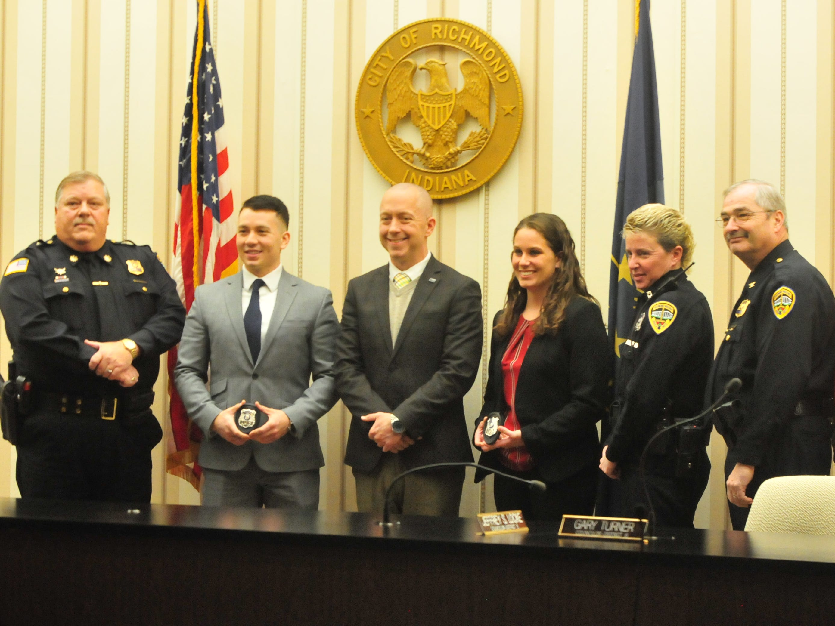 Joshua Anicete and Jessica Thackrey pose for photographs with Major Mike Britt (from left), Mayor Dave Snow, Officer Ami Miller, Chief Jim Branum and Officer Aaron Stevens.