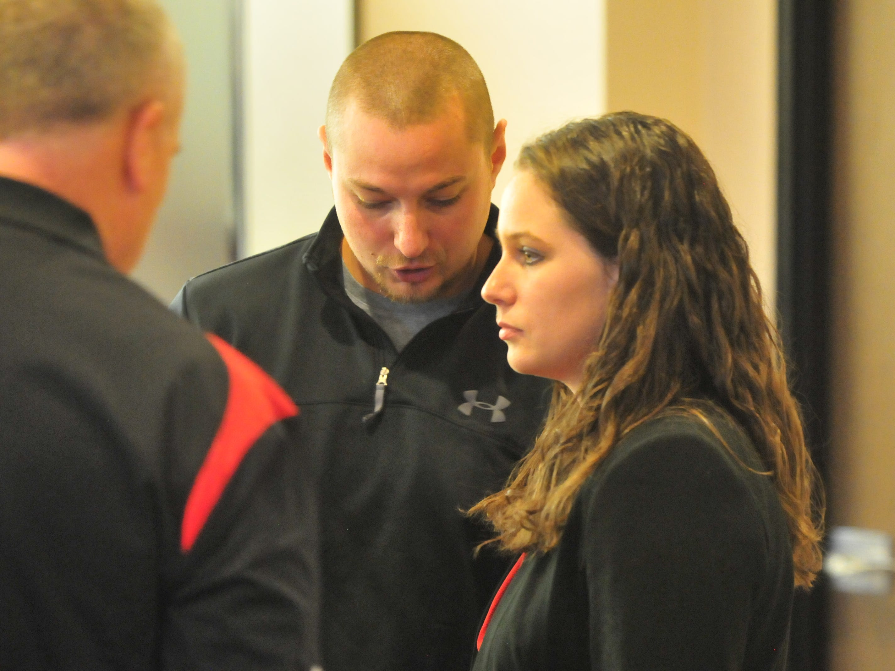 Amanda Thackrey receives congratulations Monday after she was sworn in as a Richmond Police Department officer.