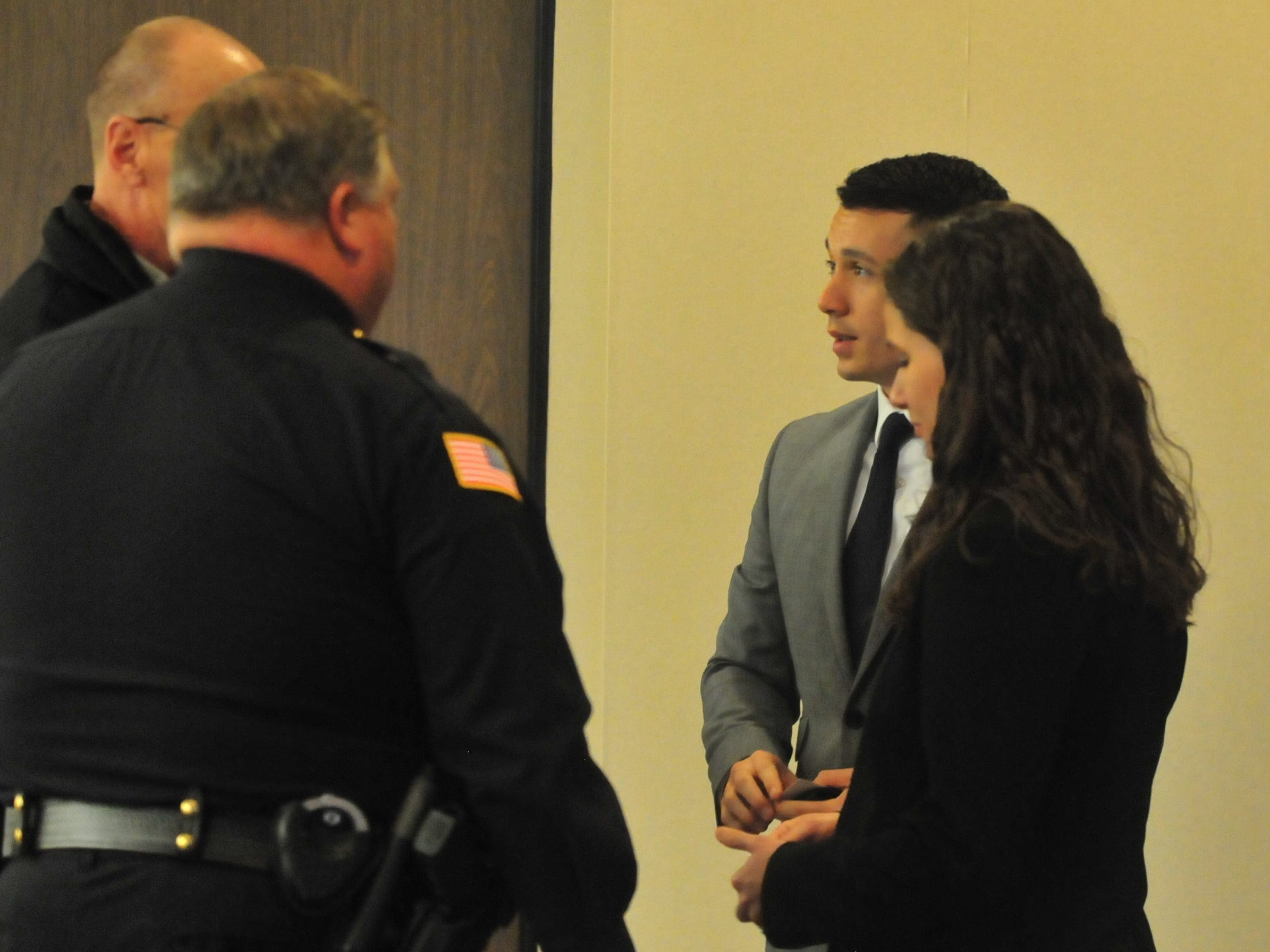 Joshua Anicete and Amanda Thackrey receive congratulations after being sworn in Monday as Richmond Police Department officers.