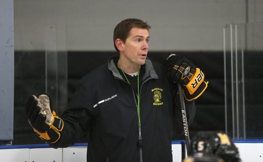 """Jeff Lovier, head hockey coach at McQuaid has helped rally his team around senior teammate Cooper Petrone who was diagnosed with non-Hodgkin's lymphoma. The team has started a GoFundMe site to help raise money for Cooper's family and is wearing lime green laces, stick tape, """"Cooper Strong'' wristbands and helmet stickers with his initials and number 27. Lime green is the support color of lymphoma."""