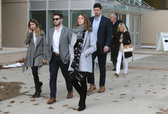 Supporters of Charlie Tan leave the federal courthouse in Syracuse after Tan received a 20 year sentenced on an illegal weapons charge.