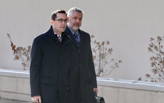 Charlie Tan's attorneys Brian DeCarolis and James Nobles head into federal court in Syracuse for Tan's sentencing on a weapons charge.