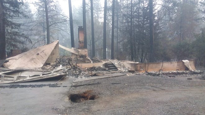 "Tim McGrath, 77, lost his home on Laurel Drive in Paradise. ""At least the chimney's still standing,"" he said."